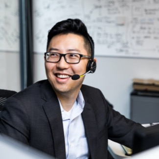 Person wearing headset and smiling
