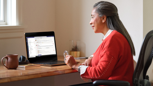 elder woman working on laptop
