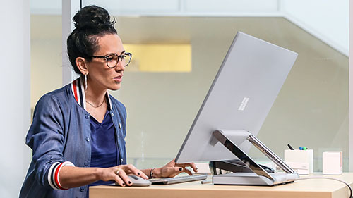 Woman with Surface studio