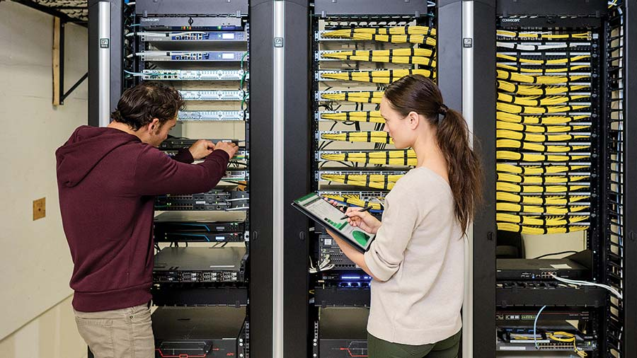 man and woman stacking servers
