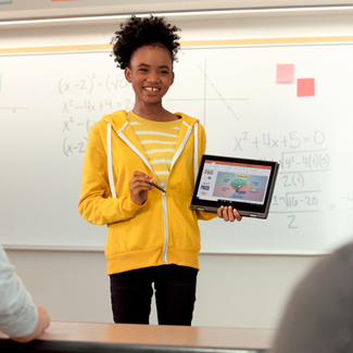 Student presenting on a tablet in a classroom