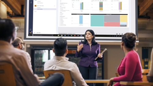 Woman presenting data in classroom.