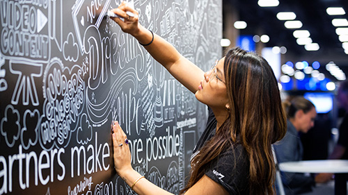 A person writing on a digital chalkboard