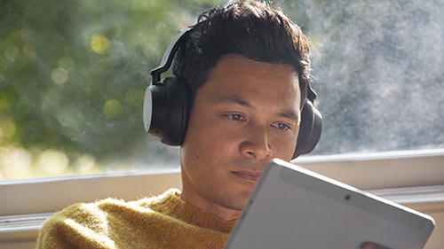 Person using a tablet with headphones