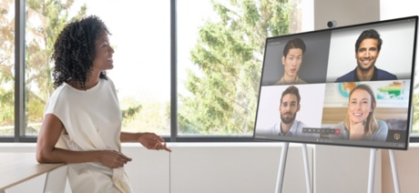 Woman talking to a Surface Hub on a video call