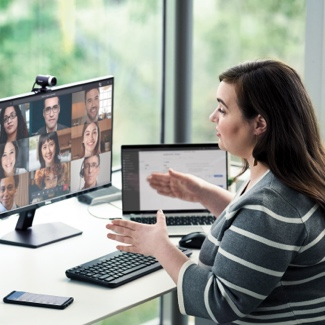 Woman at a desk talking on a video call