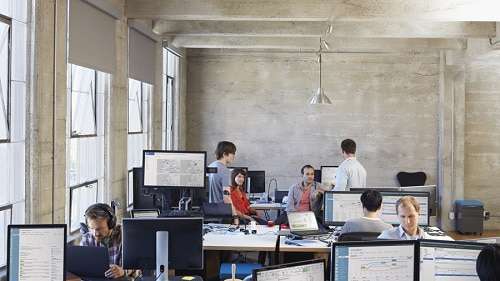 People working in an open office with computers