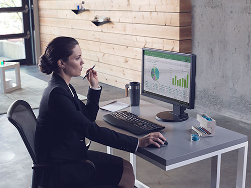 Woman working at desk on computer