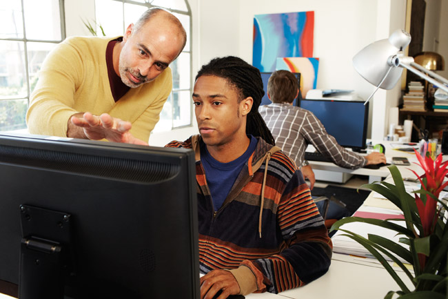 Two men looking at a computer screen