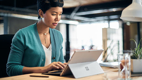 Woman working on Surface
