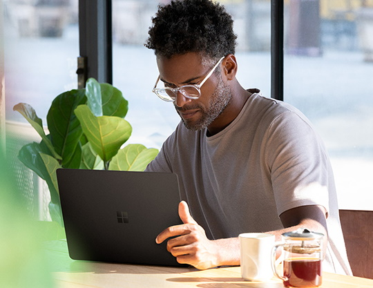 Man working on a Microsoft Surface laptop