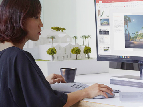 Woman working on Surface Studio