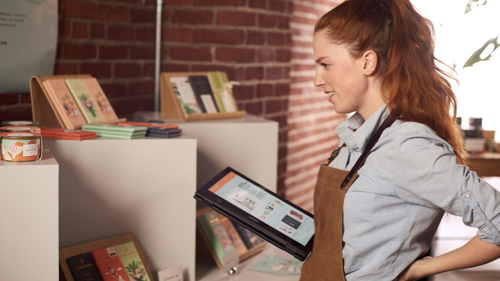 Worker in retail environment using tablet
