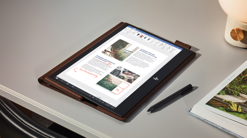 Tablet device on table with stylus beside it