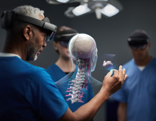 Group of medical coworkers assessing a three dimensional skeleton