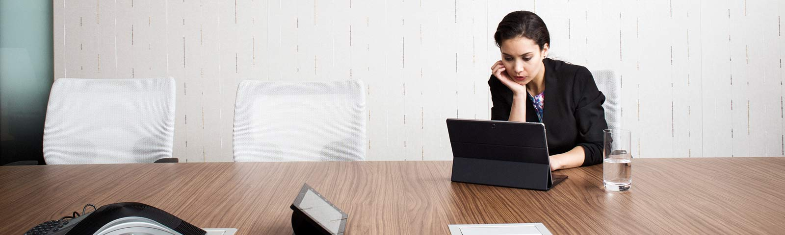 Woman working alone in conference room