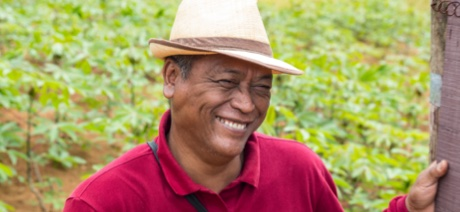 Person smiling outside wearing a hat