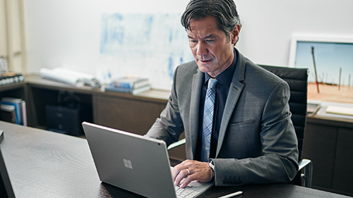 Man using laptop at a desk