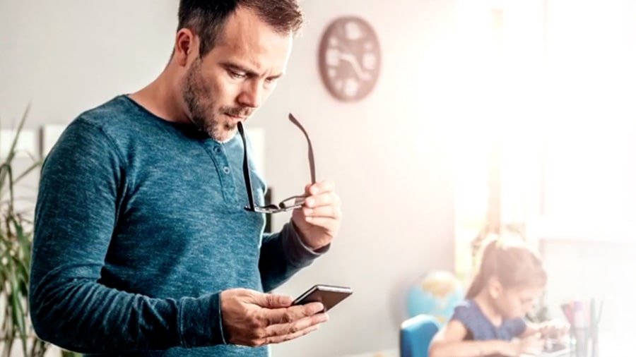 Man at home working on smartphone