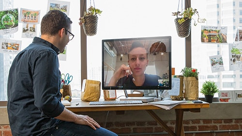 Man and woman having a video meeting