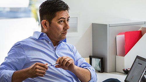Man sitting at desk with Surface tablet