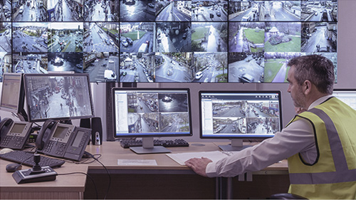 Officer monitoring security cameras