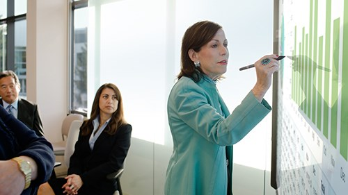 Woman giving presentation while working on Surfacehub