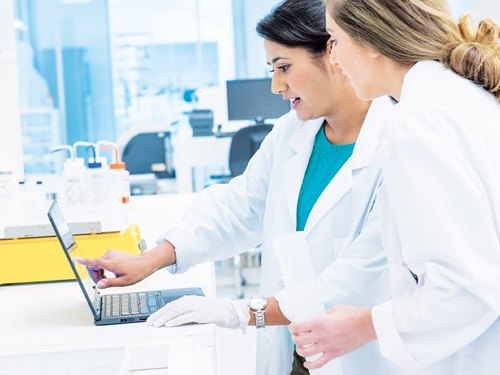 Two women working together  in lab