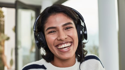 Person wearing headphones smiling