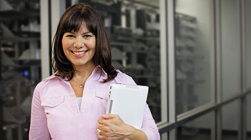 Woman standing outside of a server room