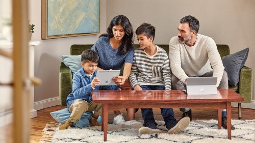 Family using Surface on couch