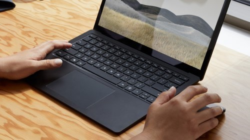 Close-up of person using Surface Laptop 3