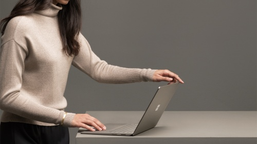 Image of a woman using a Surface Book