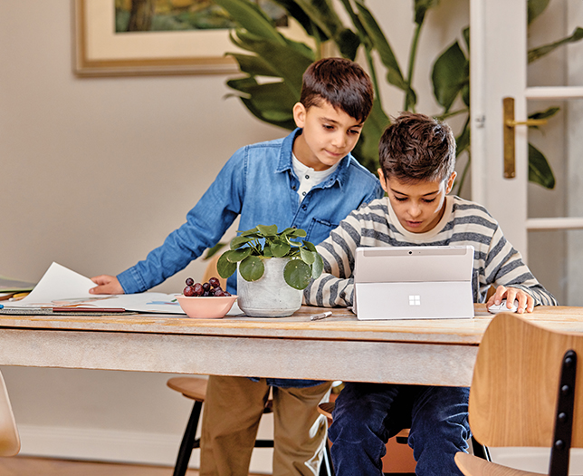 Young students working at home on Surface Go