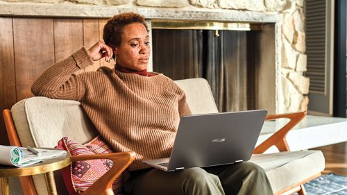 Person sitting on the couch using laptop