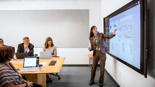 woman presenting project work flow with team member