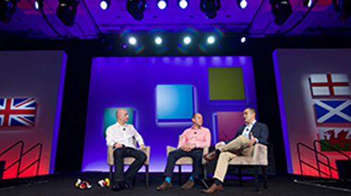 Three presenters discuss the state of business in home regions with Microsoft
