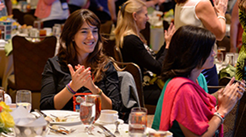 Women in Technology networking and celebrating one another at their annual luncheon.