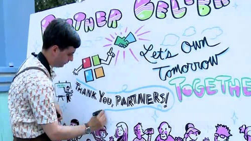 Man drawing on whiteboard at Microsoft Worldwide Partner Conference