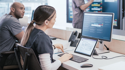 Woman working in office on computer