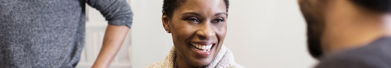Woman in meeting smiles