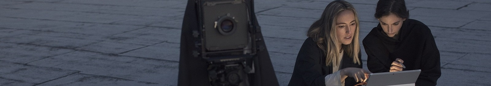 Two women set up a camera