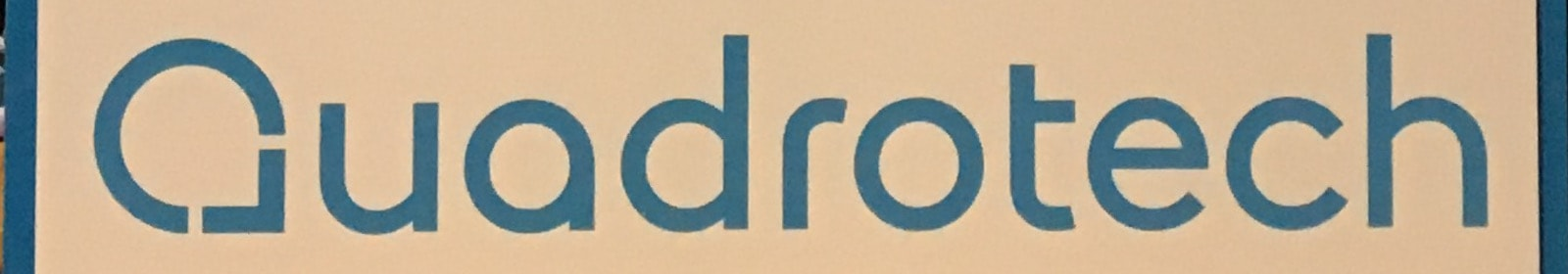 Quadrotech logo at an event