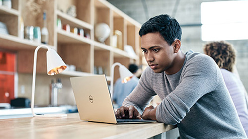 Man with laptop on table
