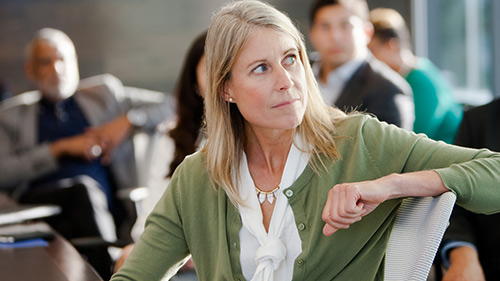 Woman sitting in chair listening to a presentation