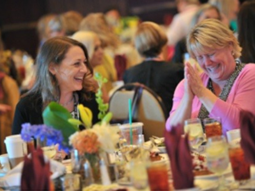 Two women network at the Women In Technology conference