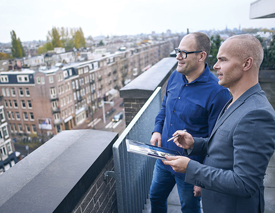 Two men discuss marketing opportunities with Microsoft
