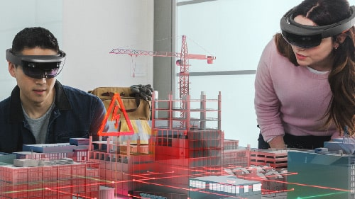 Two people using HoloLens