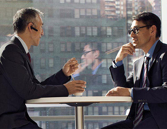 Two businessmen talking and having coffee.