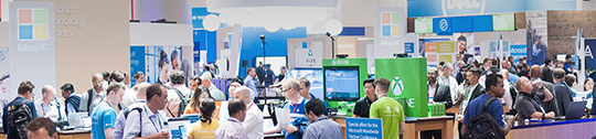 People wander around booths set up during Microsoft Inspire